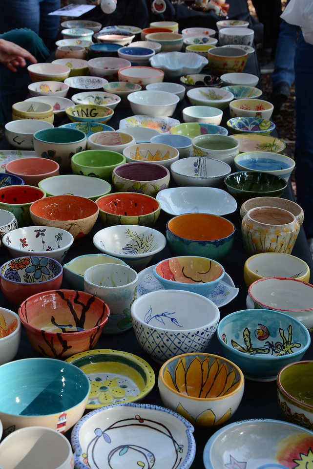 Hand painted bowls that attendees pick and keep as a reminder to help feed their community